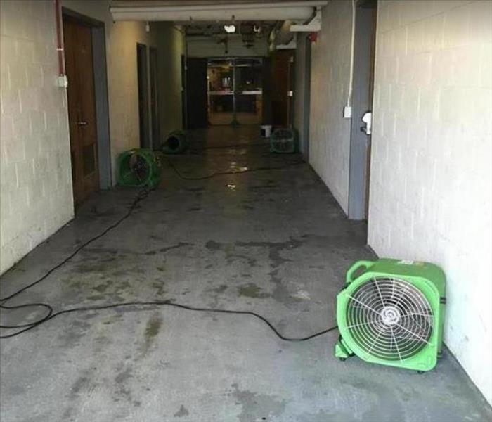 SERVPRO drying equipment being used in water damaged office buiding