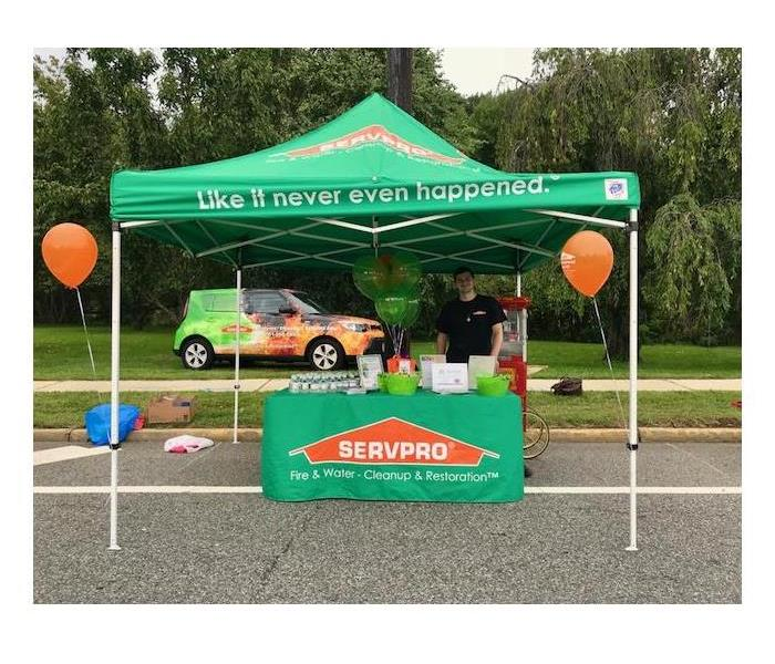 SERVPRO tent giving away information